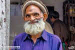 Happy Poor Old Man Standing By The Roadside In Murree